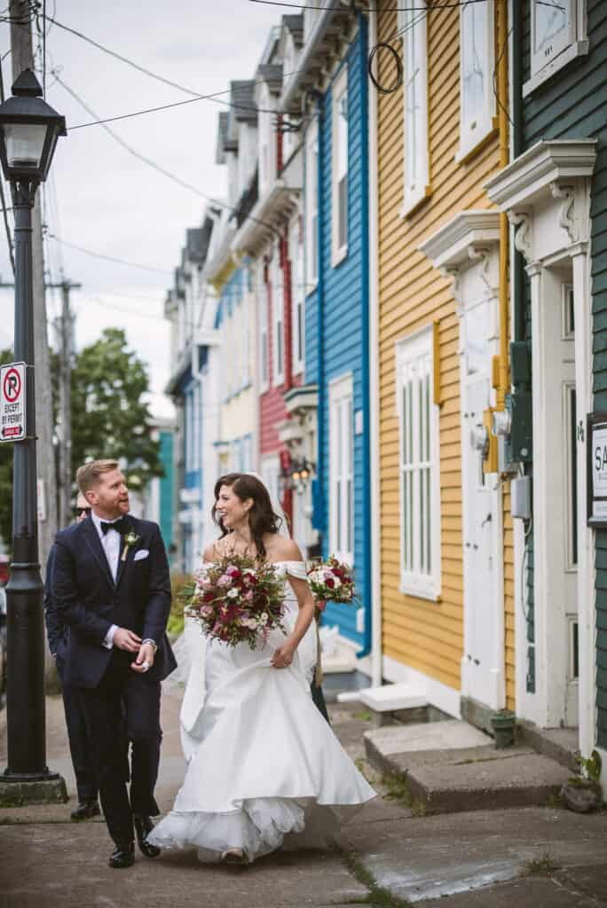 bride and groom walk down jellybean row in st johns